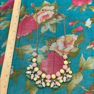 Statement wreath necklace in pink green and yellow